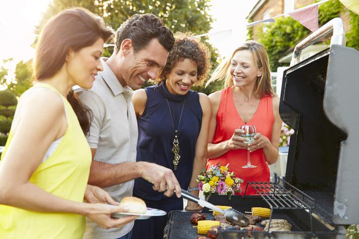 Mature Friends Enjoying Outdoor Summer Barbeque In Garden iStock-498310240.jpg