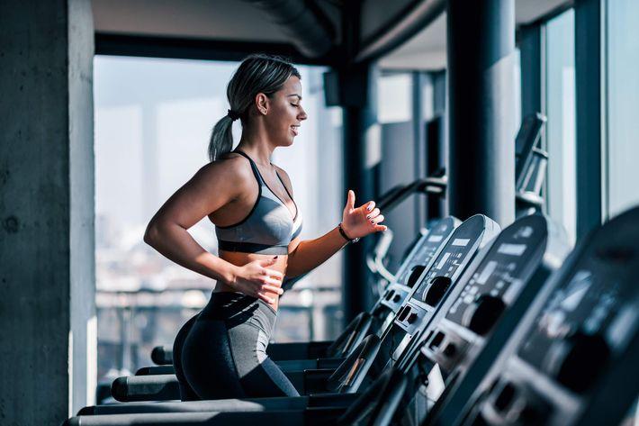 Gym-Fitness-Woman-Treadmill-Upscale-Modern-1132086660.jpg