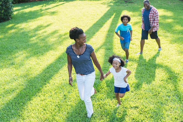 Family with mixed race children outdoor playing, walking iStock-541134950.jpg