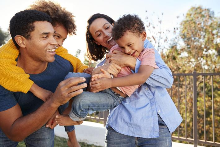 african_american-family-sunset-laughing-1126430872.jpg