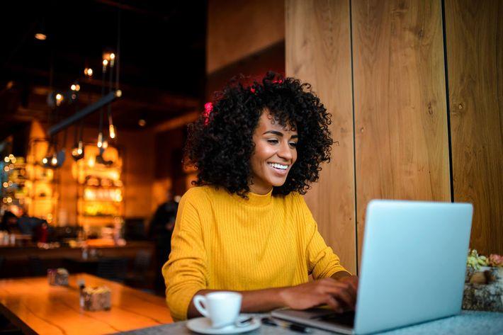 African-American-Black-Woman-Coputer-Smiling-1135176767.jpg