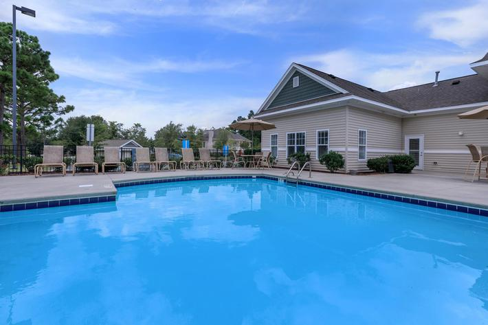 Relax by the poolside at Willow Glen in Wilmington, NC.