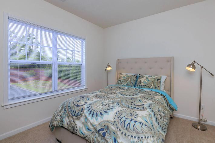Comfortable bedrooms at Willow Glen in Wilmington, North Carolina.