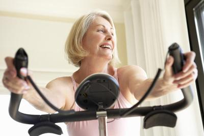 Senior Woman On Exercise Bike.jpg