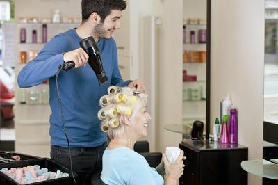 Senior woman having her hair dried.jpg