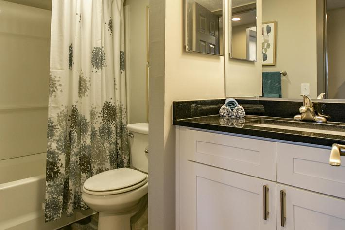 Runaway Bay renovated bathroom commode and sink.jpg