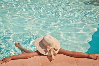 Woman in a pool hat relaxing in a blue pool iStock_000047226924_Full.jpg