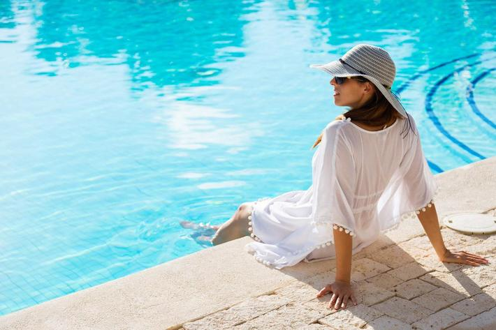 woman relaxing at poolside on summer vacation iStock-516651880.jpg