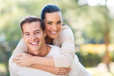 young couple piggybacking iStock_000051037472_Large.jpg