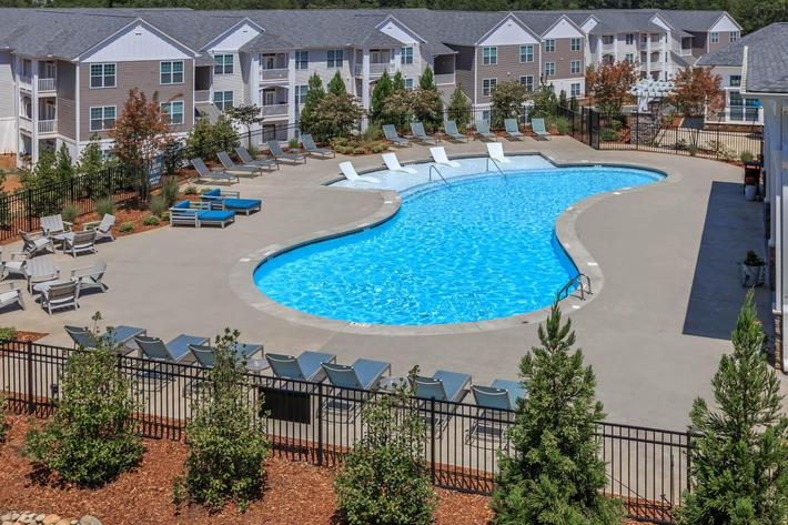 Cool Down By The Pool At Riverstone Apartments At Long Shoals In Arden, NC