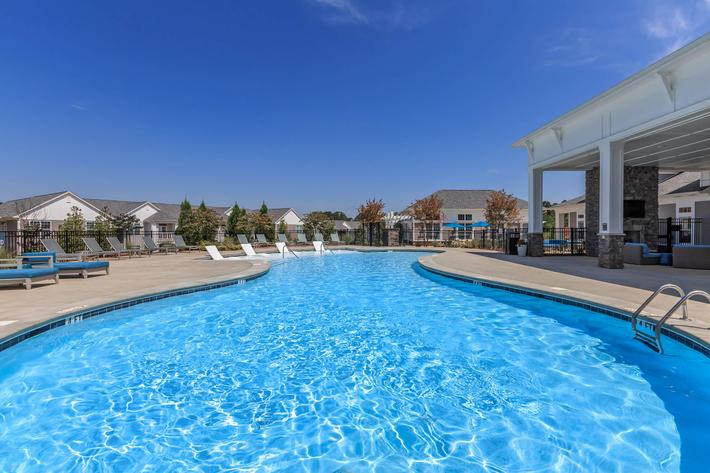 Dive Into A Shimmering Swimming Pool At Riverstone Apartments At Long Shoals In Arden, North Carolina