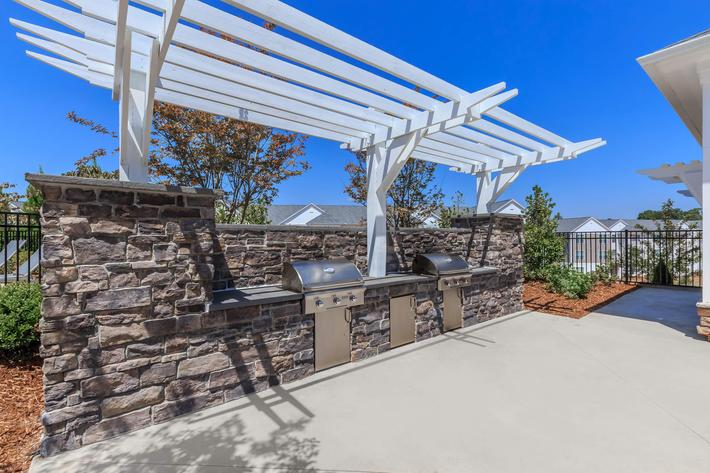 Enjoy A Barbecue with Friends At Riverstone Apartments At Long Shoals In Arden, NC