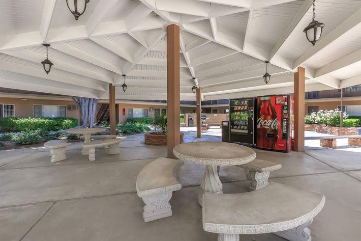 Picnic tables under community gazebo