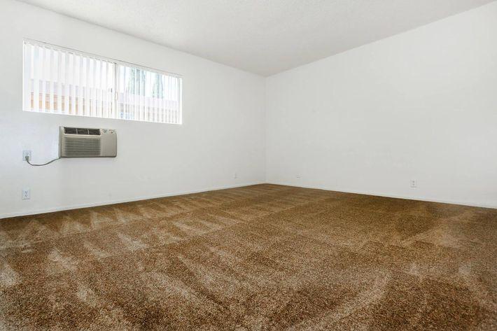 Unfurnished bedroom with carpet