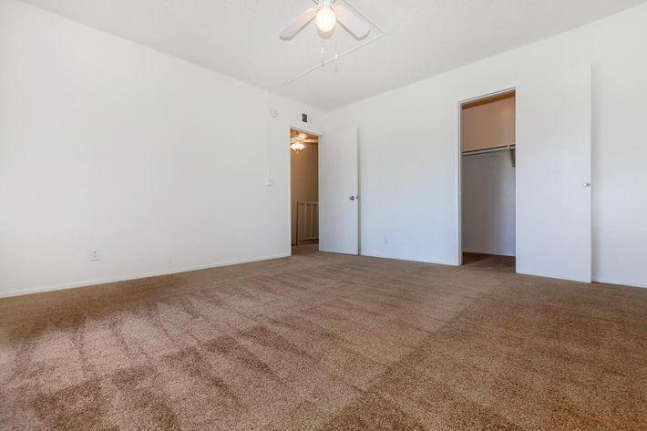 Unfurnished bedroom with open sliding closet door