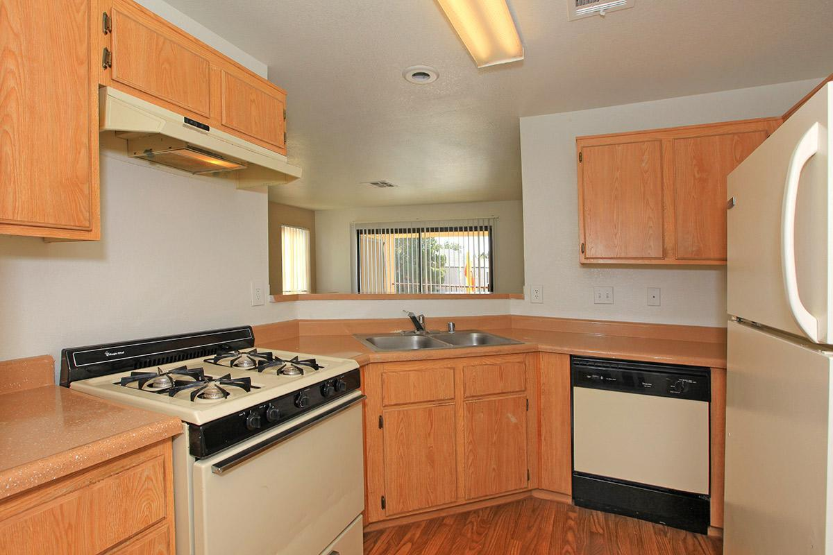 FULLY-EQUIPPED KITCHEN AT TOSCANA APARTMENT HOMES IN LAS VEGAS