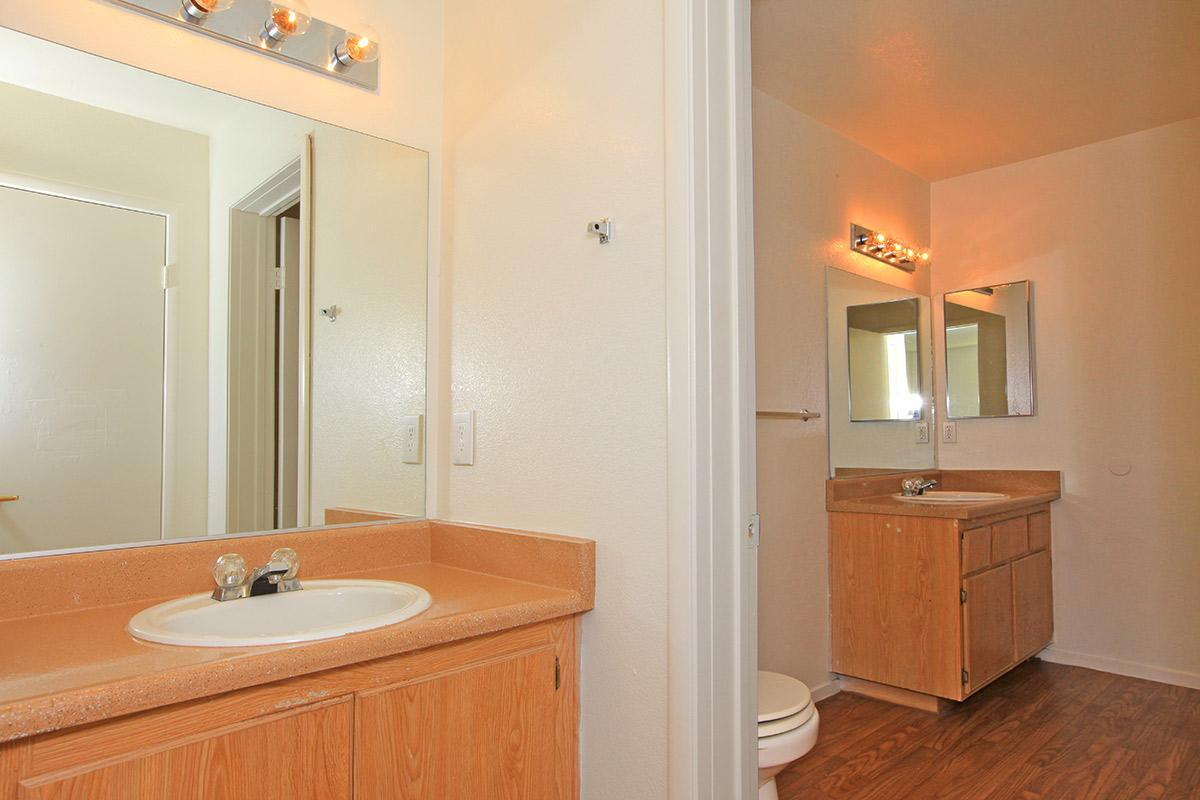 WASHROOM WITH TWO VANITIES AT TOSCANA APARTMENT HOMES IN LAS VEGAS