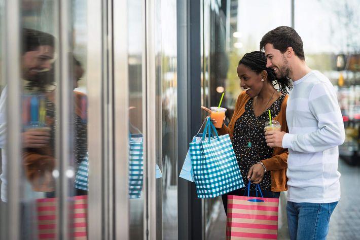 Young couple window shopping iStock-532179230.jpg