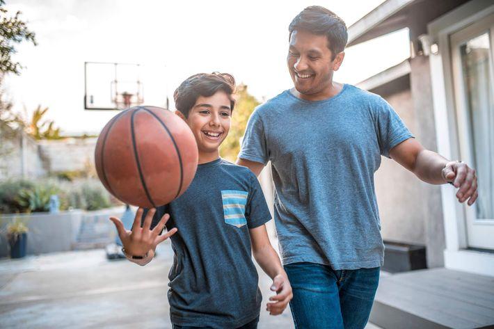 Ethnic-Father-SOn-Basketball=Smiling-1128316823.jpg
