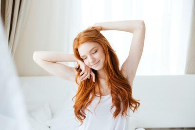 interior-bedroom-woman sitting in bed.jpg