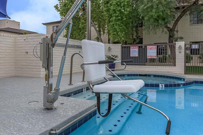 a chair sitting in front of a pool of water