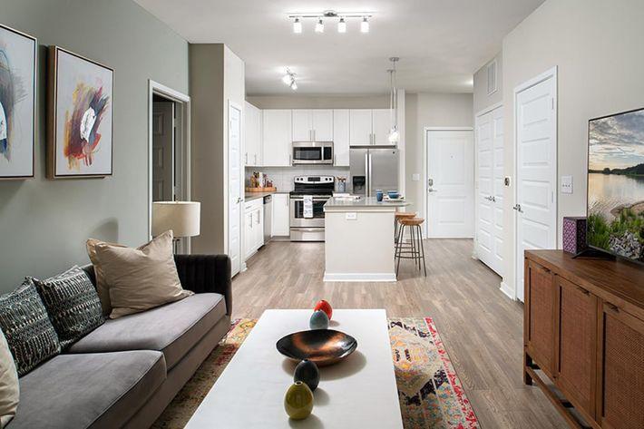 Bainbridge-Lake-Crabtree-Model-Living-Room-to-Kitchen.jpg