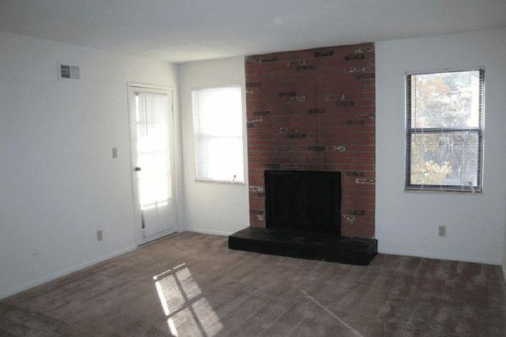 1 bed living room showing patio door.jpg
