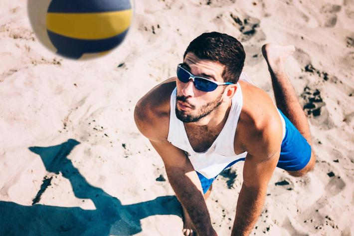 Beach volleyball player receiving the ball, action shot iStock-534567612.jpg