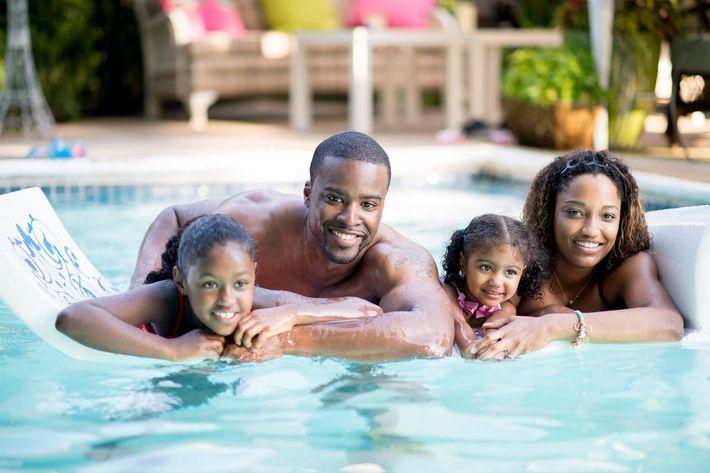 Family in pool-iStock-468483734.jpg