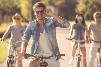Friends cycling in park iStock-618221008.jpg