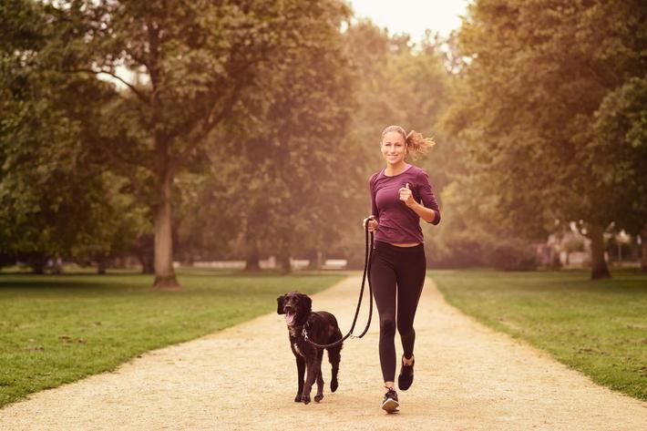 Healthy Woman Jogging in the Park with her Dog iStock-488515352.jpg