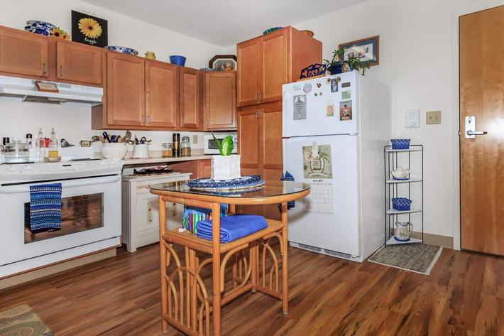 a kitchen filled with appliances and wooden cabinets