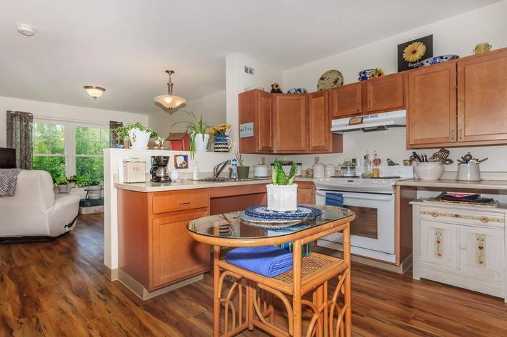 a kitchen with an island in the middle of a living room