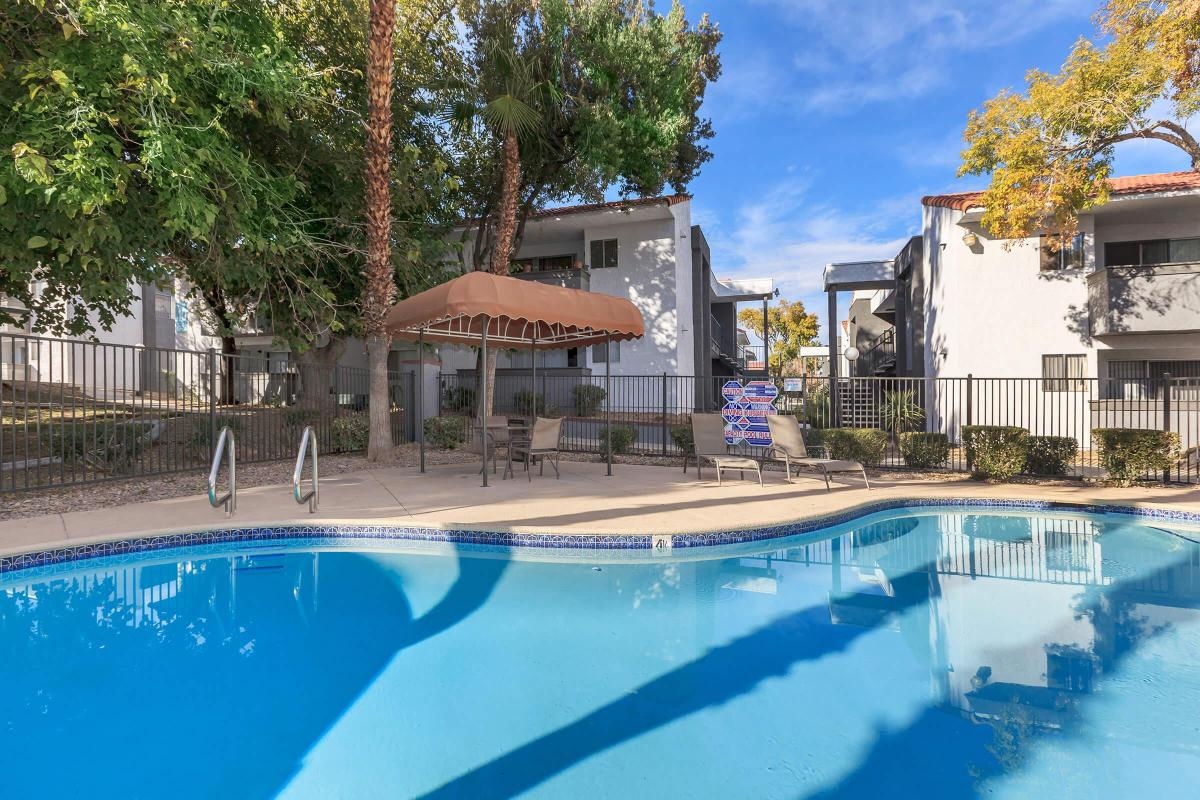 RELAX BESIDE OUR SHIMMERING SWIMMING POOL AT VILLA DEL SOL IN LAS VEGAS