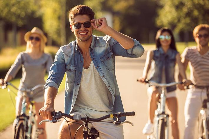 Friends cycling in park.jpg