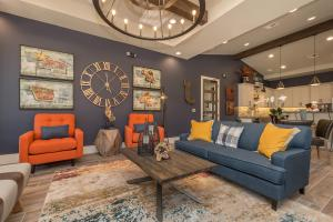 a living room filled with furniture and a clock