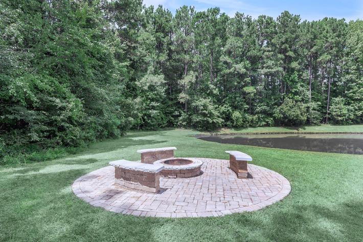 Cozy Up To The Fire Pit Here At Cooper's Ridge in Ladson, South Carolina