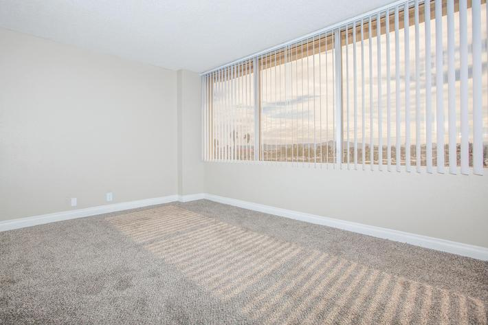 CARPETED FLOORS AND VERTICAL BLINDS AT MARK 1 APARTMENTS IN LAS VEGAS
