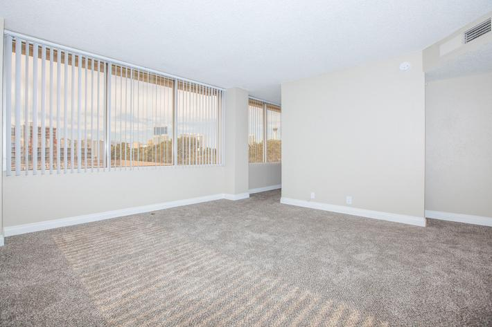 CARPETED FLOORS AND VERTICAL BLINDS AVAILABLE AT MARK 1 APARTMENTS IN LAS VEGAS
