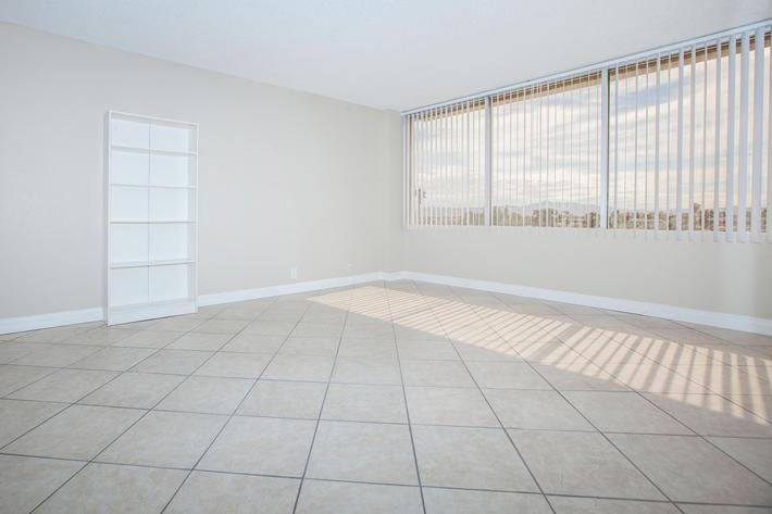 VERTICAL BLINDS AND TILE FLOORING AVAILABLE AT MARK 1 APARTMENTS IN LAS VEGAS