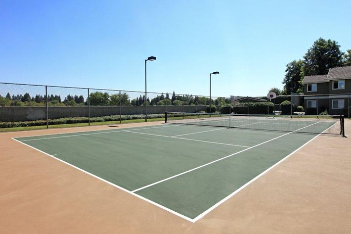 We have a lighted tennis court at Sierra Meadows