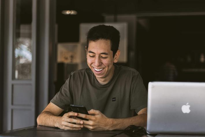 man at cafe with laptop and phone.jpg