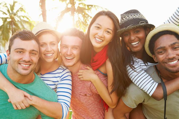 Group Of Friends Having Fun In Park Together iStock_000047000230_Large.jpg