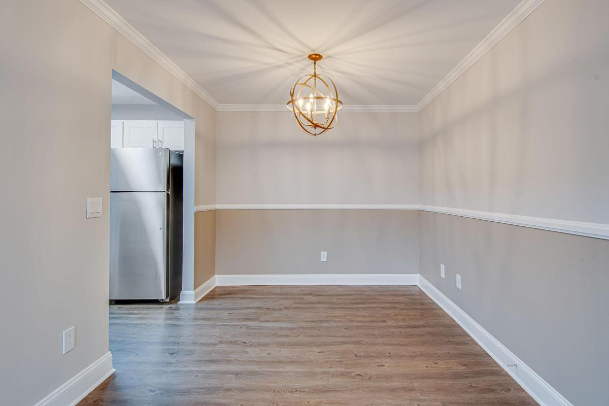 Dining area with wood style flooring