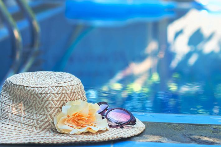 hat and pool-914478524.jpg