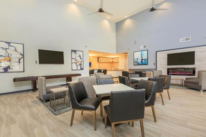 CLUBHOUSE WITH ENTERTAINMENT ROOM, TVS, AND GOURMET KITCHEN