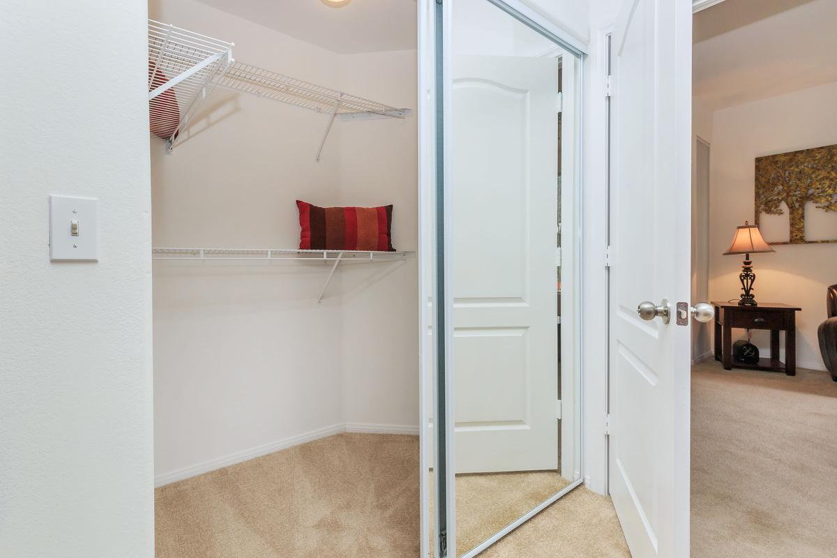 PLENTY OF CLOSET SPACE IN HENDERSON APARTMENT HOMES AT THE SUMMIT AT SUNRIDGE APARTMENTS