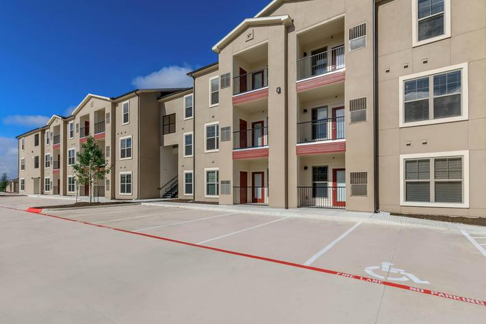 Leander Apartments for Rent - Hills at Leander Exterior with Plenty of Parking, Private Balconies, and Much More