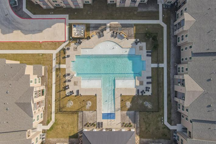 Apartments for Rent Leander - Hills at Leander Sparkling and Relaxing Pool with Lounge Seats and Many More Amazing Community Amenities
