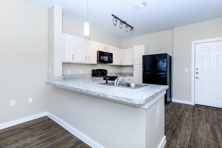 Apartments for Rent in Leander TX - Hills at Leander Spacious Kitchen with Plenty of Counterspace, Fully Equipped with Black Appliances, and Much More